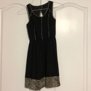 Cheetah print and black dress